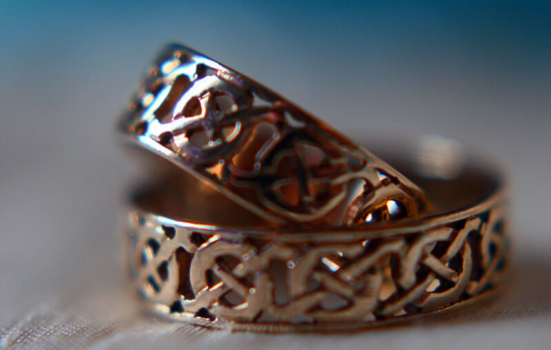 picture of metal rings with celtic symbols on them