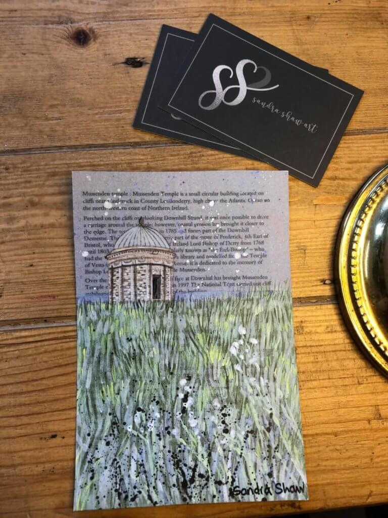 a print of mussendun temple with a poem in the background.